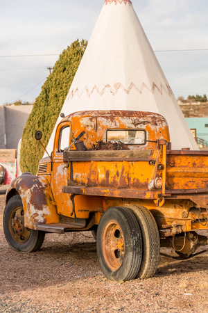 period of time: December 21, 2014 - Wigwam Hotel, Holbrook, AZ, USA: time period vehicles parked in front of the historic hotel Editorial