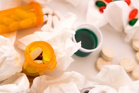 cold and flu season medicines for cough, sneeze, and sore throat Imagens