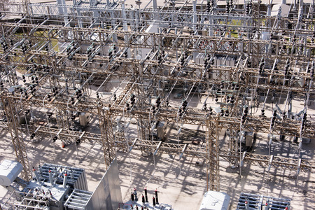 insulators: electrical power substation with transformers and insulators
