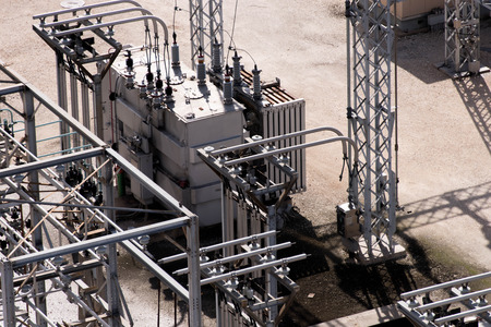 electrical power substation with transformers and insulators