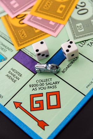 monopoly money: February 8, 2015 - Houston, TX, USA.  Monopoly  car on Go