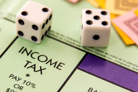 monopoly: February 8, 2015 - Houston, TX, USA.  Monopoly car on Income Tax