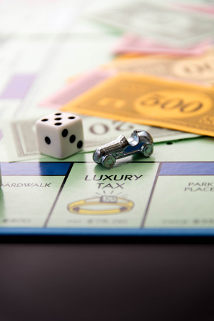 February 8, 2015 - Houston, TX, USA.  Monopoly game board with car on Luxury Tax