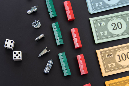 February 8, 2015 - Houston, TX, USA.  Monopoly money, and playing pieces in rows Editoriali