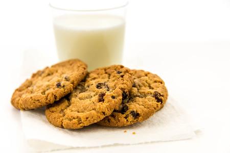 glass of milk and oatmeal raisin cookies
