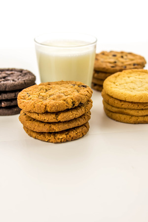 glass of milk and a variety of cookies Banco de Imagens