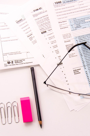 tax preparation supplies reading glasses and blank tax forms stock