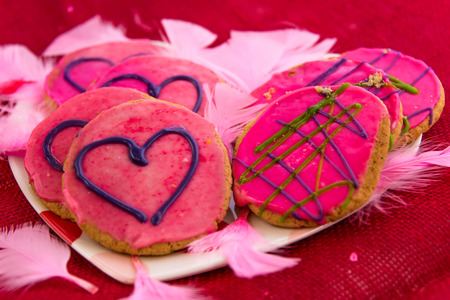 frosting': Valentines Day - cookies with pink frosting and hearts Stock Photo