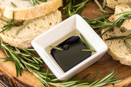 carbs: a fresh baked loaf of rosemary bread and olive oil and balsamic vinegar