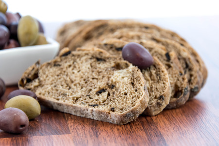 carbs: fresh baked olive bread and olives Stock Photo