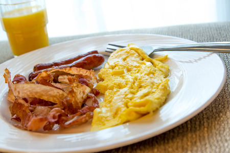 eggs and bacon: hearty eggs, bacon and sausage breakfast on a plate