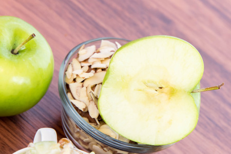 nutriment: healthy snack: apple slices and nuts Stock Photo