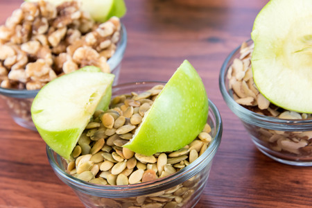 healthy snack: healthy snack: apple slices and nuts Stock Photo