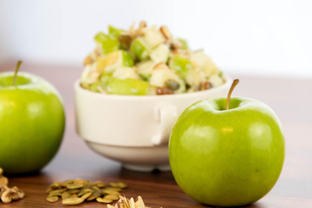 nutriment: healthy snack: apple salad with almonds, walnuts and pumpkin seeds, condensed milk and lemon juice