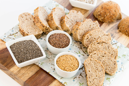 a fresh baked loaf of whole grains bread with poppy, flax adn sunflower seeds Archivio Fotografico