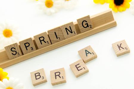 and spelling: December 19, 2014: Houston, TX, USA - Scrabble word game wood tiles spelling Spring Break Editorial