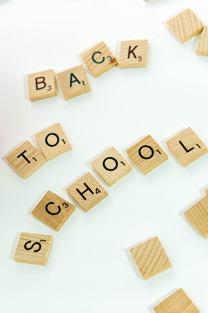 tx: December 19, 2014: Houston, TX, USA - Scrabble word game wood tiles spelling Back To School