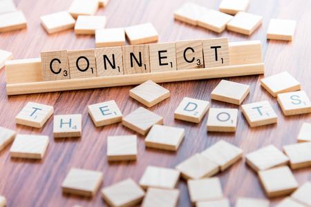 connection: April 4, 2015:  Houston, TX, USA - Scrabble Word Game wood tiles spelling Connect The Dots Editorial