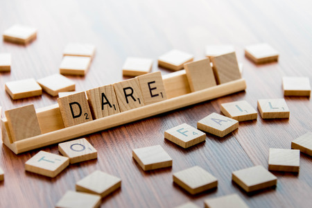 word game: April 4, 2015:  Houston, TX, USA - Scrabble Word Game wood tiles spelling DARE TO FAIL Editorial