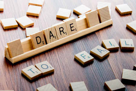 dare: April 4, 2015:  Houston, TX, USA - Scrabble Word Game wood tiles spelling DARE TO FAIL Editorial