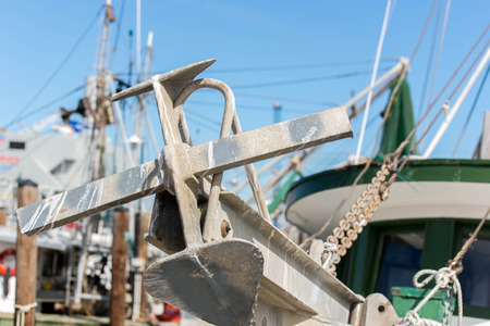 fishing industries: commercial fishing boats with nets at the ocean marina docks