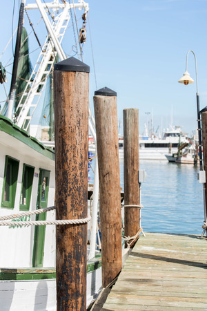 commercial docks: commercial fishing boats with nets at the ocean marina docks