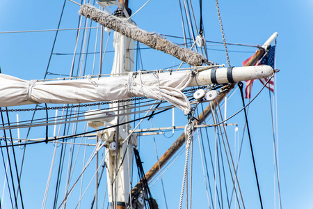 arma: masts, rigging and rolled up sails of a tall sailboat Stok Fotoğraf