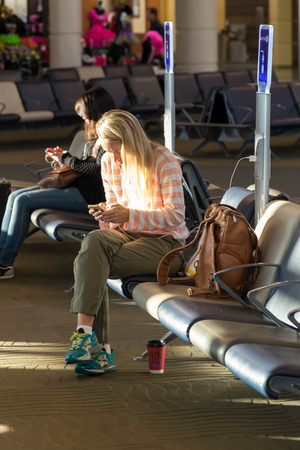louis armstrong: MSY, Louis Armstrong New Orleans International Airport, New Orleans, LA, USA - October 15, 2015:  passengers walking with lugagge in airport Editorial