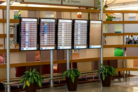 louis armstrong: MSY, Louis Armstrong New Orleans International Airport, New Orleans, LA, USA - October 15, 2015:  flight information display screens