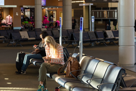 MSY, Louis Armstrong New Orleans International Airport, New Orleans, LA, USA - October 15, 2015:  passengers walking with lugagge in airport Editorial