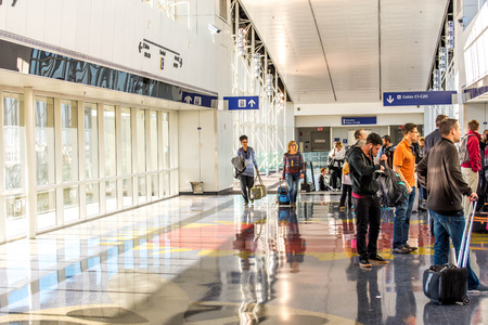 airport: DFW, Dallas Fort Worth International Airport, Dallas, TX, USA - November 10,2014: passengers waiting for the Skylink train