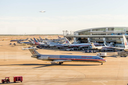 fort worth: DFW, Dallas Fort Worth International Airport, Dallas, TX, USA - November 10,2014: view through a window of the airport ramp operations