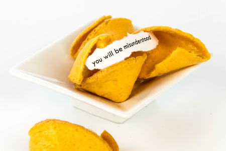open fortune cookie with strip of white paper - YOU WILL BE MISUNDERSTOOD Stok Fotoğraf