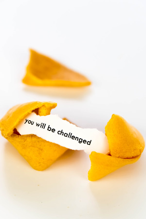 open fortune cookie with strip of white paper - YOU WILL BE CHALLENGED Stok Fotoğraf