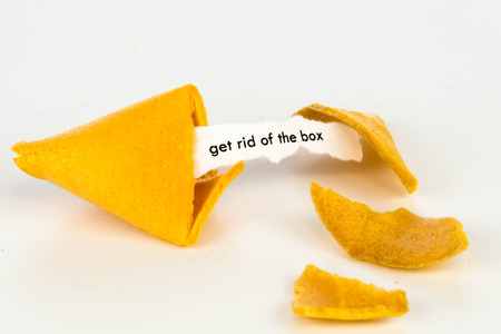 bad fortune: open fortune cookie with strip of white paper - GET RID OF THE BOX Stock Photo