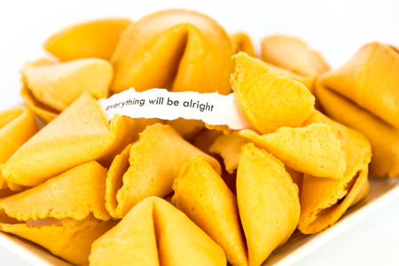 alright: open fortune cookie with strip of white paper - EVERYTHING WILL BE ALRIGHT