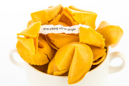 bad fortune: open fortune cookie with strip of white paper - EVERYTHING WILL BE ALRIGHT