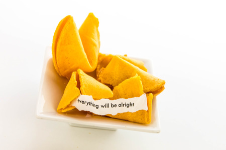 open fortune cookie with strip of white paper - EVERYTHING WILL BE ALRIGHT