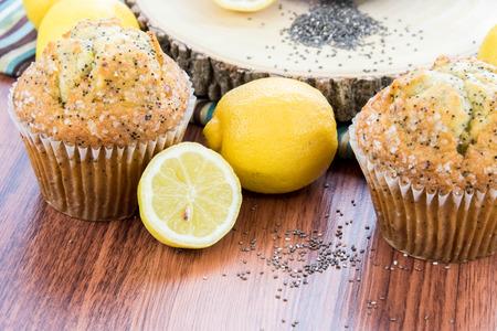 fresh baked lemon poppyseed muffins adn lemons and poppyseeds