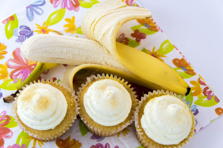 yellow banana vs yellow cupcake - snack decision between healthy food or junk food