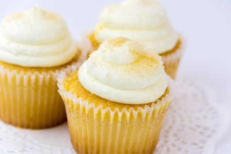 yellow lemon cupcakes with white frosting Stock Photo