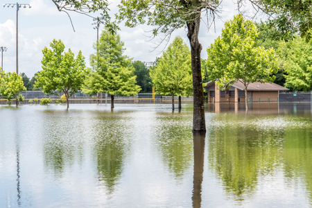 Standing flood waters over roads and fields Stock Photo