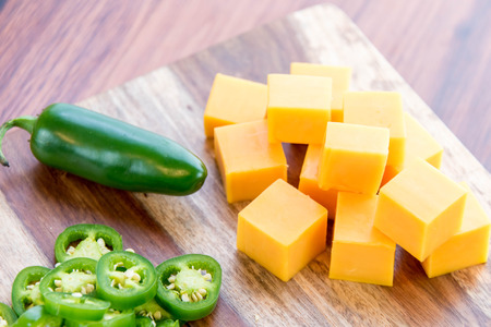 fresh sliced jalapeno peppers and cheddar cheese Imagens