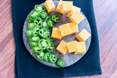 jalapeno: fresh sliced jalapeno peppers and cheddar cheese Stock Photo