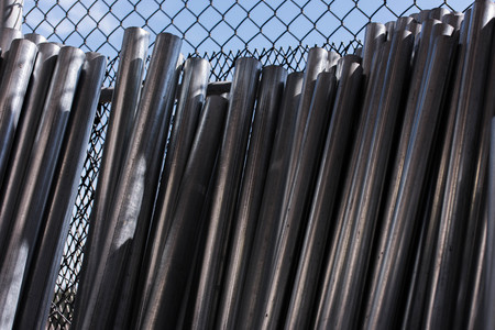 outdoor building materials - stacked chainlink fence posts