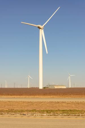 wind turbines in the desert with a blue sky Foto de archivo