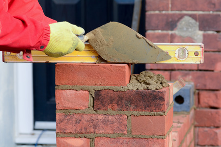 Bricklaying - checking brick is level