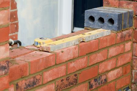 Bricklaying tools on wall 写真素材