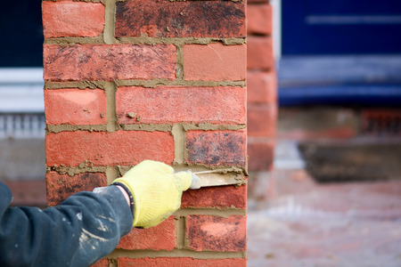 Bricklaying  pointing work Stock Photo