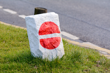 onto: No entry road sign painted onto rock Stock Photo